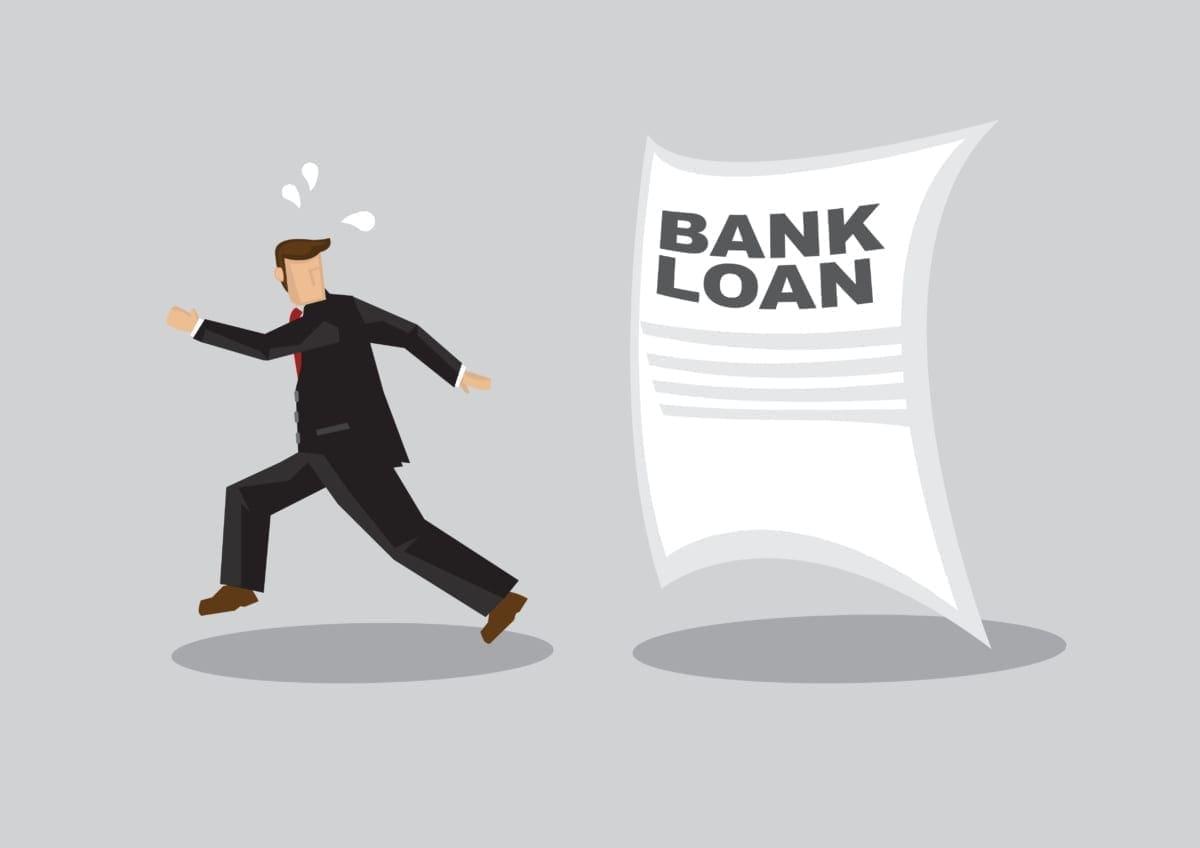 Cartoon of a businessman running away from a bank loan document Auckland